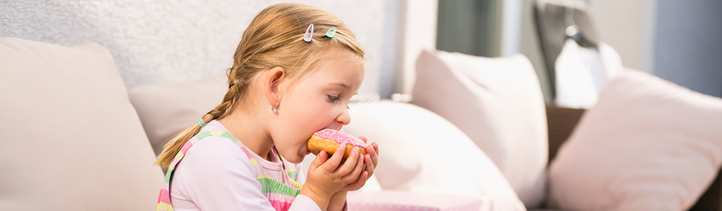 girl eating doughnut
