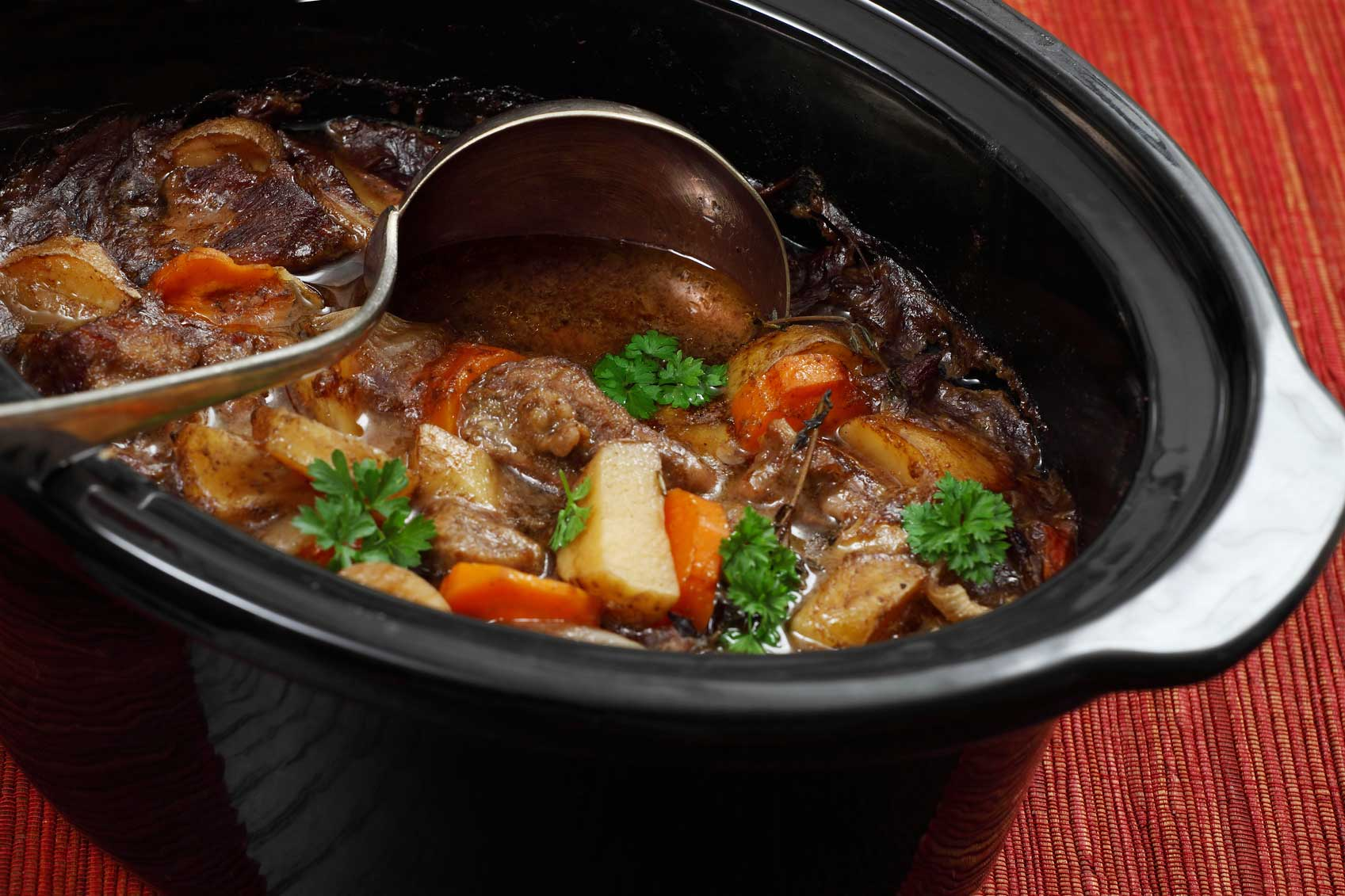 Stirring slow cooker contents