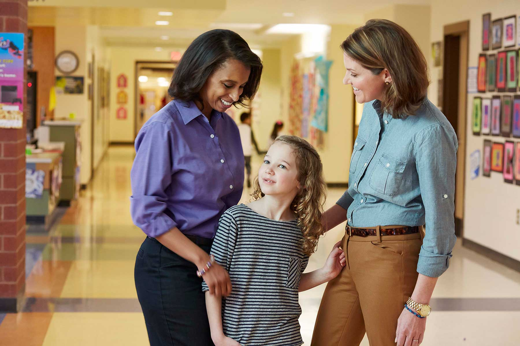 mom and daughter with school nurse