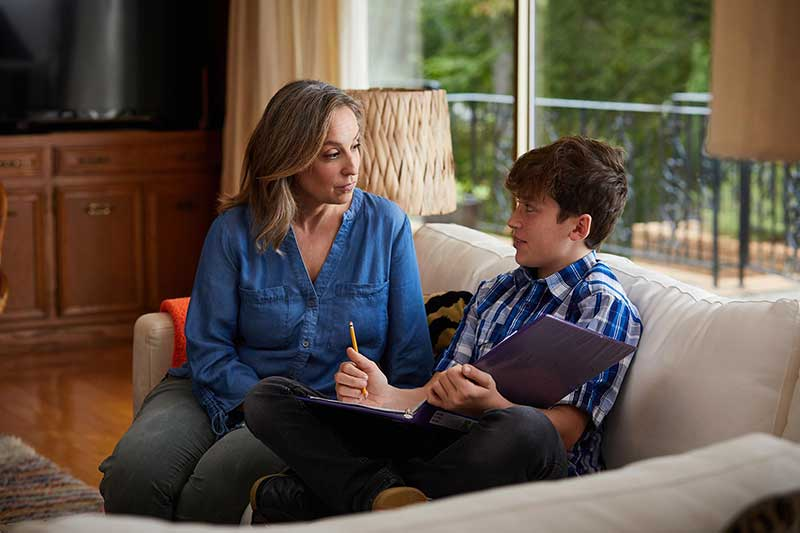 mom talking to son on couch