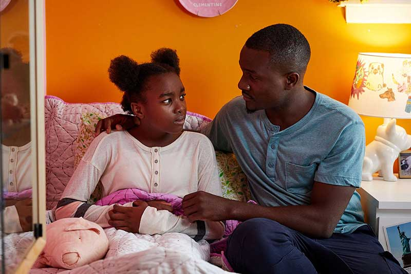 father consoling daughter in her bedroom