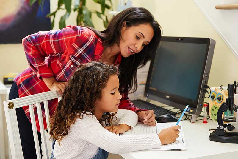 daughter studying for test with mom's help