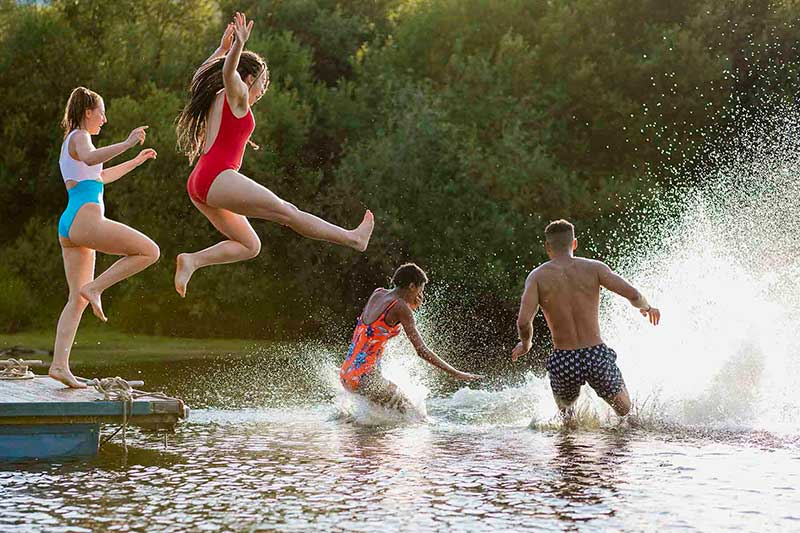 teens jumping into the lake